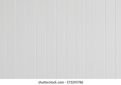 White wall wooden groove vertical texture. wall panel spray white color design of decoration.