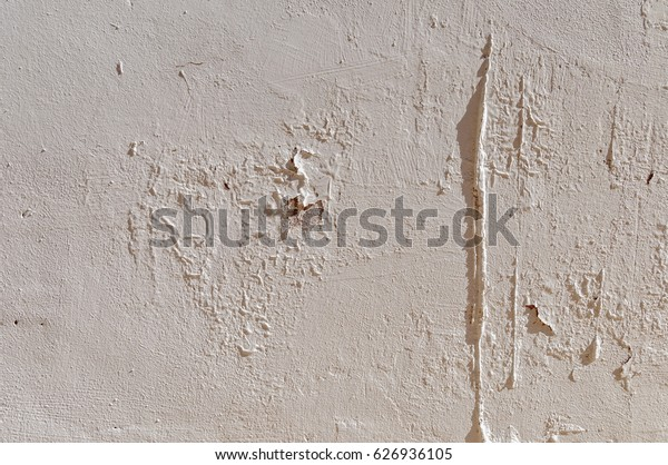 white wall with worn surface