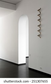 White walls and arched doorway inside contemporary building
