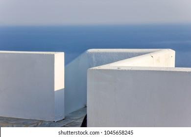 White walls and stairs next to orthodox church on the Skiathos island, Greece