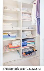white wardrobe full of clean towels
