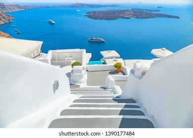 White wash staircases on Santorini Island, Greece. The view toward Caldera sea with cruise ship.