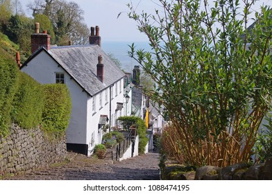 White washed cottage beside a very steep street in the center of Clovelly in the northern part of Devon, England