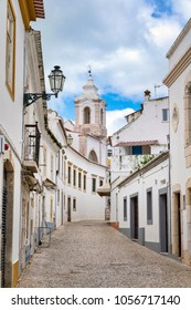 white washed old city street in Portugal