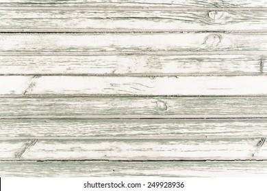 White washed painted grunge wood plank background texture, horizontal image.