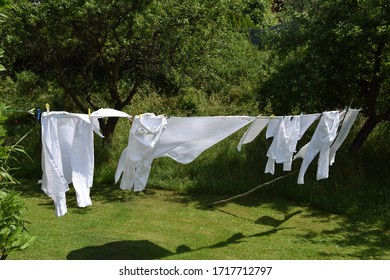 White washing drying on the line on a sunny day