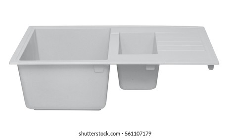 white washing of the granite kitchen with deep drying of cutlery on a white background side view
