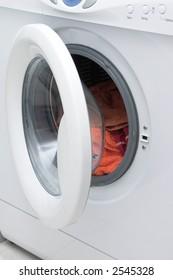 White washing machine with open door.