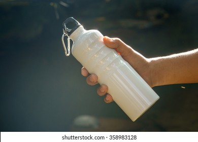 White water bottle of the type used by outdoors people like climbers, walkers and campers on nature background.