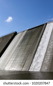 White water overspill run off on the stark sunlit concrete wall of Llys y Fran Reservoir Dam, Pembrokeshire, Wales, UK