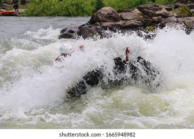 White Water Rafting fully Engulfed in Spray