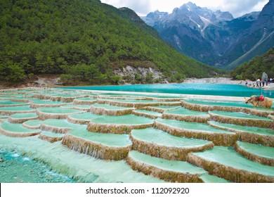 White Water River waterfall at the cliffs and brooks at the foot of Jade Dragon Snow Mountain, Lijiang, Yunnan China.