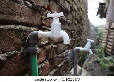White water tap beside the slum. Slum dweller take water from here.