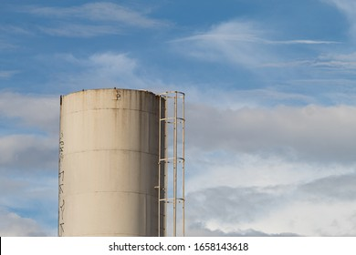 White water tower and blue sky