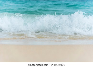 White wave on tropical summer island