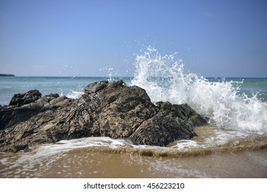 White waves crashing on the Rocky shore in Cyprus.