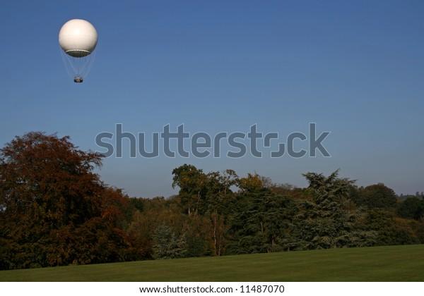 White Weather Balloon Air Above Trees Stock Photo (Edit Now