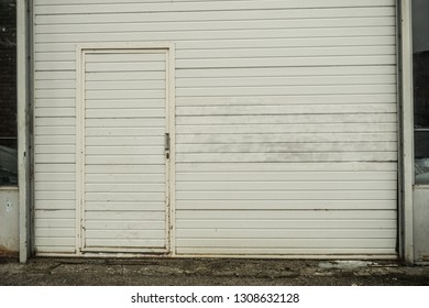 White weatherboard wall with a door.