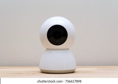 white web camera or webcam on desk with white wall background, object, internet, technology concept