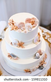 White Wedding Cake with Beach Decor