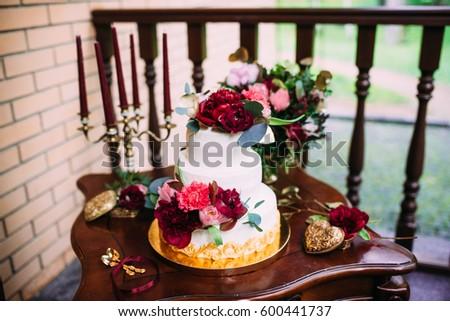 White Wedding Cake Burgundy Flowers On Stock Photo Edit Now