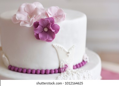 White wedding cake purple pink flowers stock photo edit now white wedding cake decorated with purple and pink flowers mightylinksfo