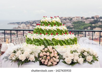 White Wedding Cake decorated with red fruit and green lemon leaf, Floreal Theme