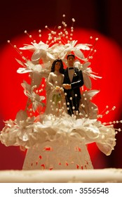 White wedding cake decoration with red light background