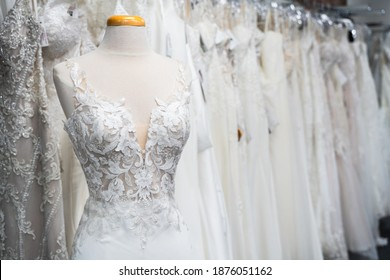 White wedding dresses in a bridal boutique
