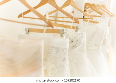 White Wedding Dresses in dress store.