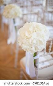 white wedding hydrangeas on aisle chairs