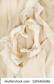 white wedding shoes worn by the beautiful Bridal
