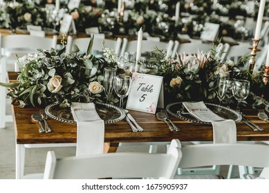 white wedding table setting with flowers and decor