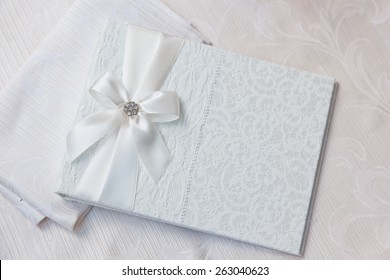 white wedding wish book decorated with bow and lace