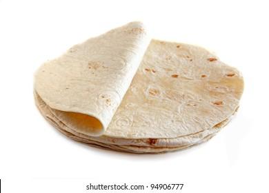 White wheat flour tortillas isolated on white background