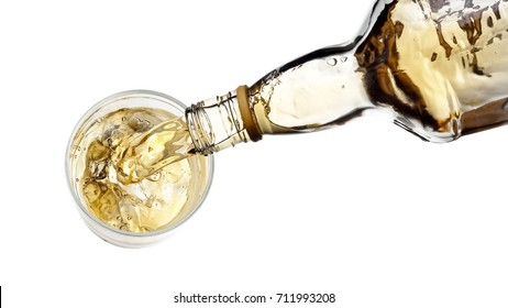 White whiskey pouring in a glass, top view