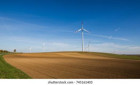 white wind power plants in a field, Austria