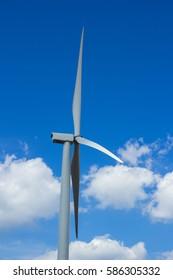 White wind turbine generating electricity, Thailand