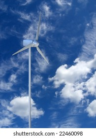 White windmill in cloudy sky