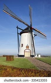 White windmill from the year 1740 in the village of Meeuwen (Aalburg) in the province of Noord-Brabant, the Netherlands