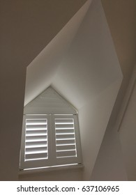 White window with closed shutters