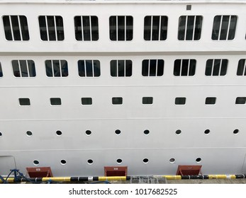 White window of cruise ship from side of harbour.