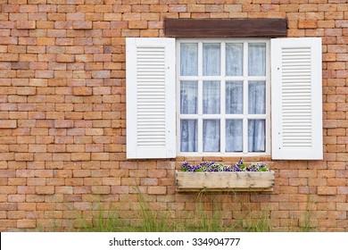 White window on brick wall