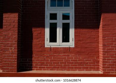 White window on  red brick backgruond