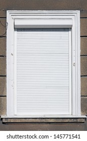 white window with roller shutter