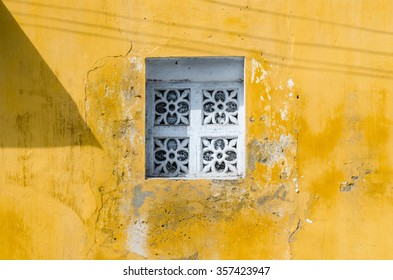 White window and yellow wall