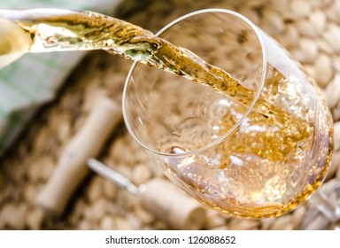 White wine being poured into a glass.