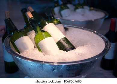 white wine bottles on ice