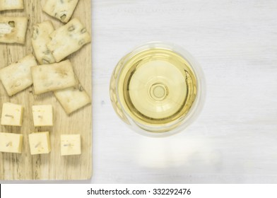White wine with cheese and snacks top view