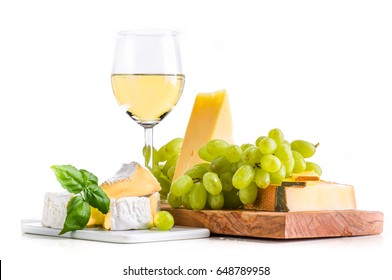 White wine with fresh cheese selection and grapes isolated on white background
